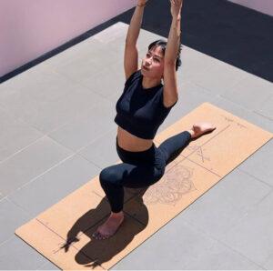 woman on cork yoga mat